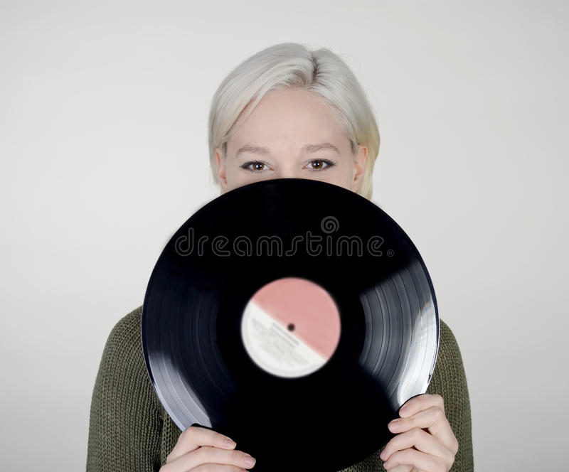 Woman with record. Happy young woman with record stock photography