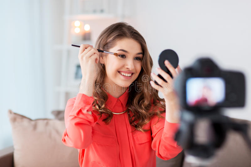 Woman recording eye makeup tutorial video at home royalty free stock image