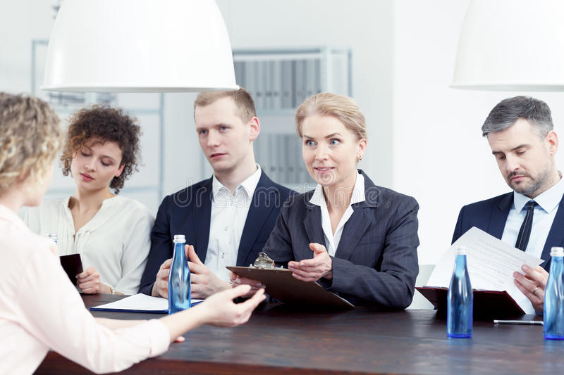 Woman from recruitment committee. Asking questions about candidate`s resume royalty free stock photos