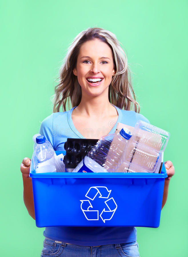 Woman with a recycle bin royalty free stock images