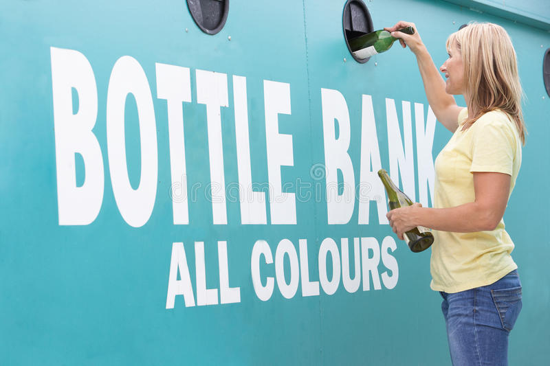 Download Woman At Recycling Centre  At Bottle Bank Stock Photo - Image: 16055960