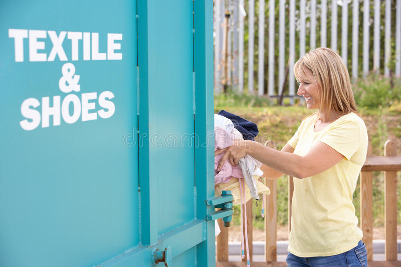 Download Woman At Recycling Centre Disposing Of Clothing Stock Photo - Image: 16055662