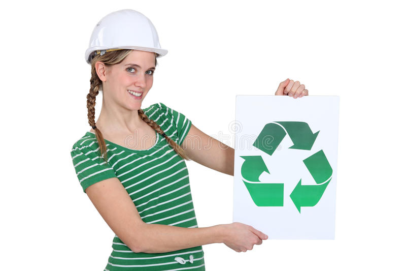 Woman with recycling symbol. Woman with sign and recycling symbol stock images