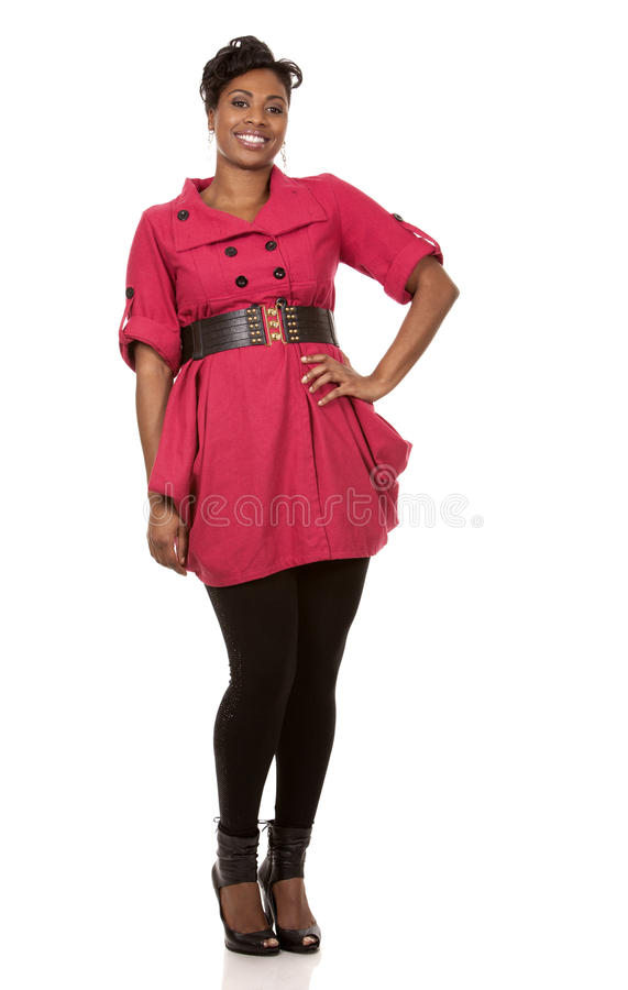 Woman in red. Pretty dark woman wearing red dress on white background royalty free stock photography