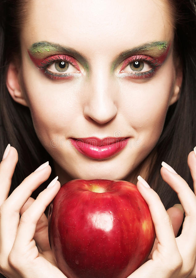 Woman with red apple. Bright woman with red apple royalty free stock photo