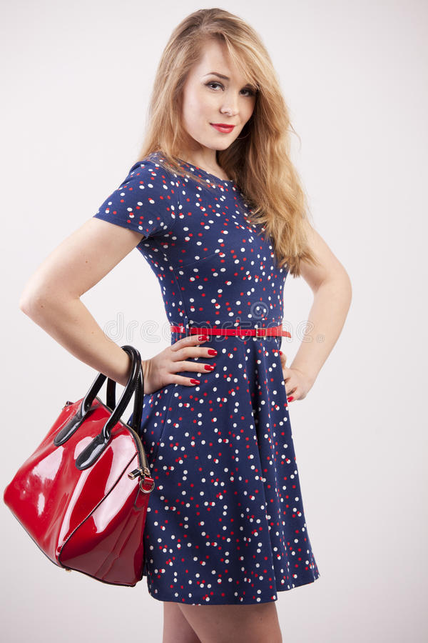Download Woman with red bag stock photo. Image of smiling, holding - 25224978