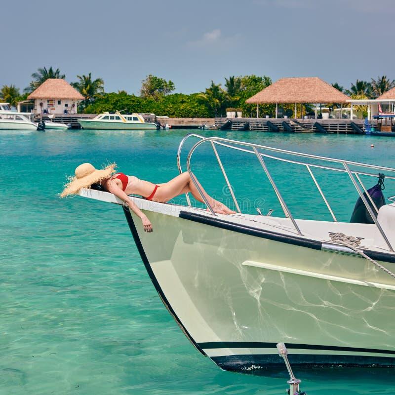 Woman in red bikini lying on boat bow. Summer vacation at Maldives royalty free stock photos
