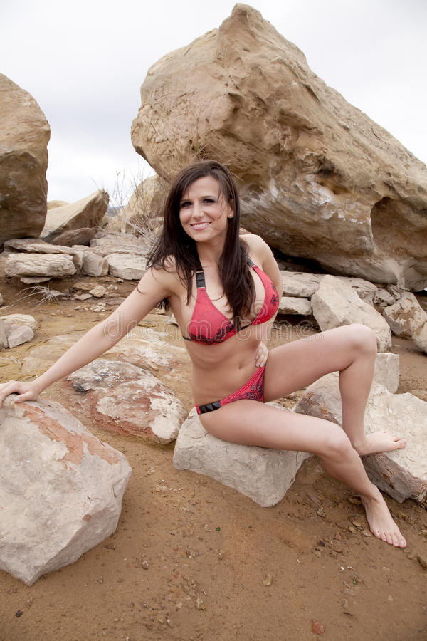 Download Woman Red Bikini Sitting On Rock Stock Images - Image: 14584214
