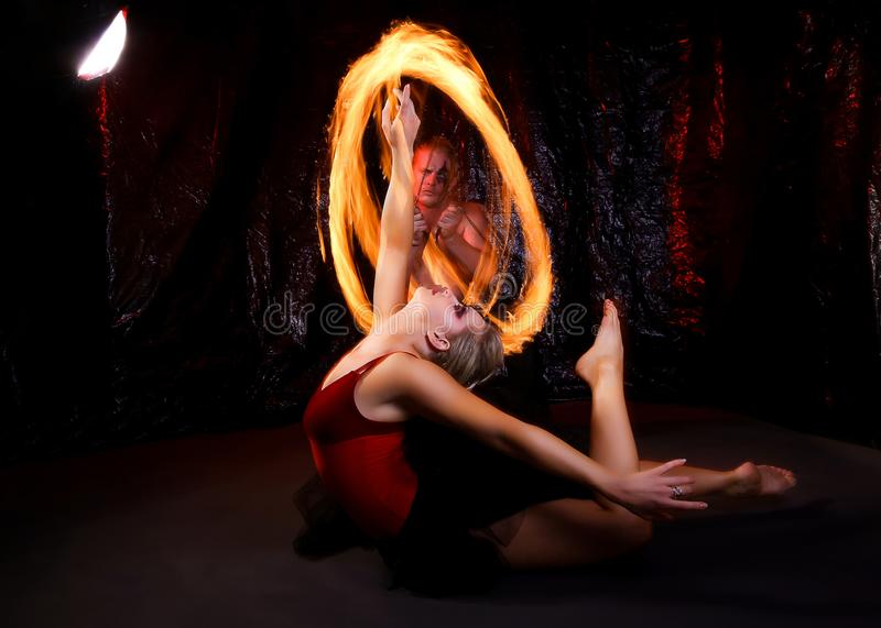 Woman in Red and Black Ballerina Dress With Steel Wool Photography stock photos