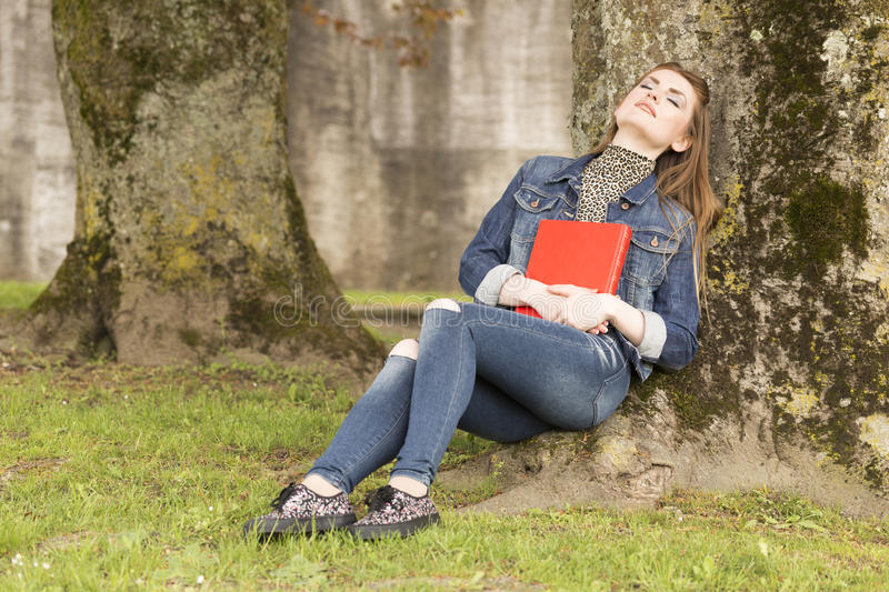 Woman_with_red_book-5 стоковые фото