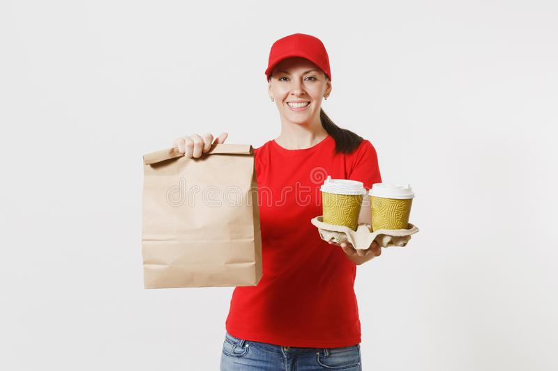 Woman in red cap, t-shirt giving fast food order isolated on white background. Female courier holding paper packet with. Food, coffee. Products delivery from stock photos