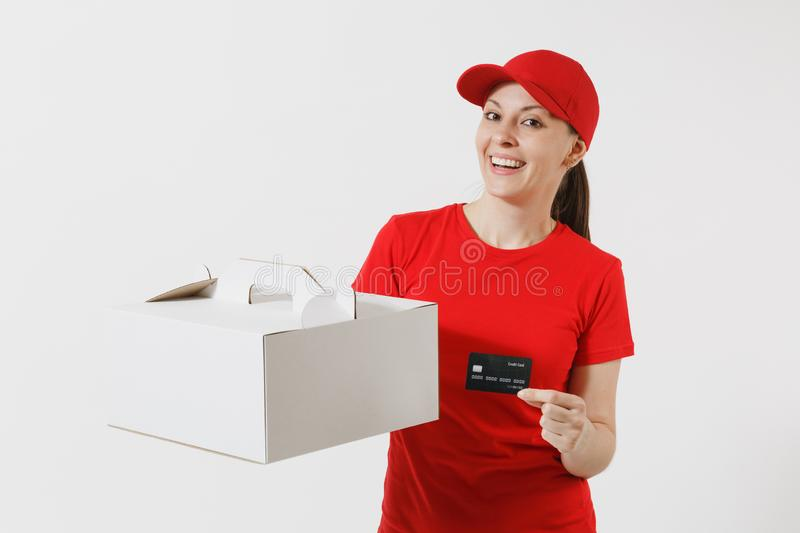 Woman in red cap, t-shirt giving food order cake box isolated on white background. Female courier holding dessert in. Unmarked cardboard box, credit card royalty free stock photography