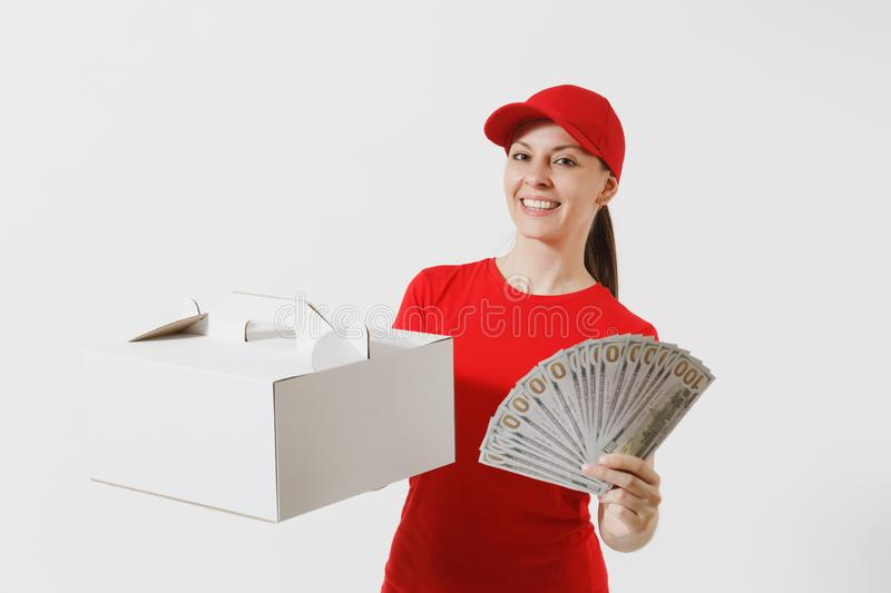 Woman in red cap, t-shirt giving food order cake box isolated on white background. Female courier holding dessert in. Unmarked cardboard box, bundle of dollars stock photo