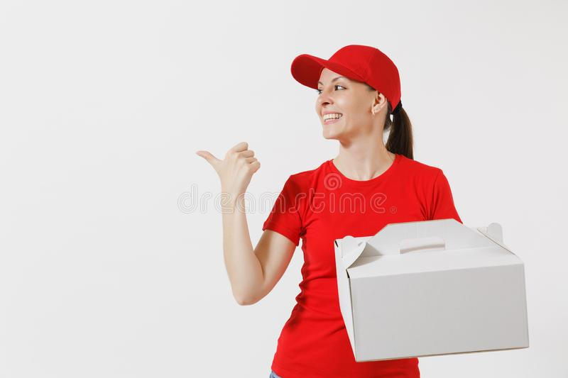 Woman in red cap, t-shirt giving food order cake box isolated on white background. Female courier holding dessert in. Unmarked cardboard box. Delivery service stock image