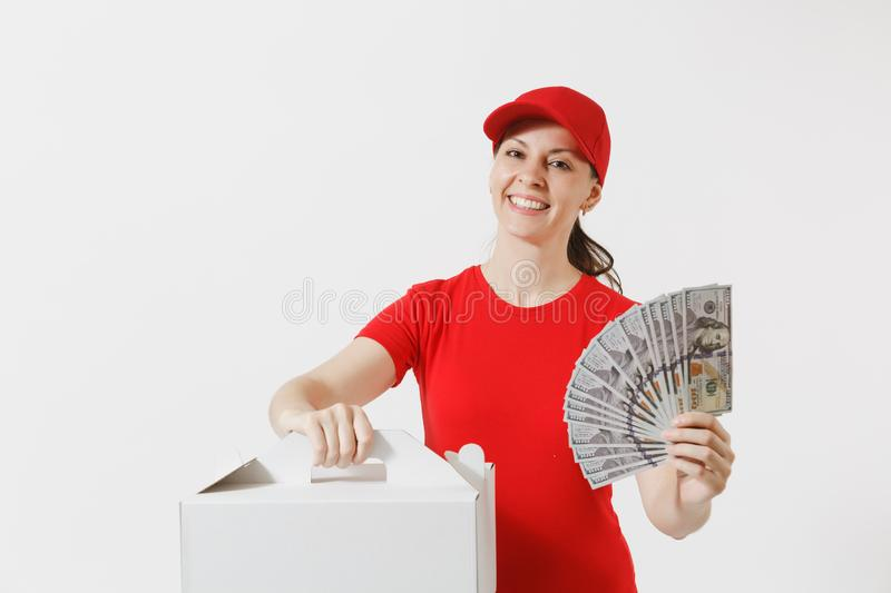 Woman in red cap, t-shirt giving food order cake box isolated on white background. Female courier holding dessert in. Unmarked cardboard box, bundle of dollars royalty free stock photography