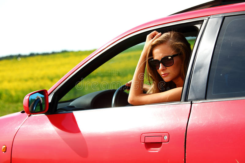 Download Woman In Red Car Royalty Free Stock Photography - Image: 17869947