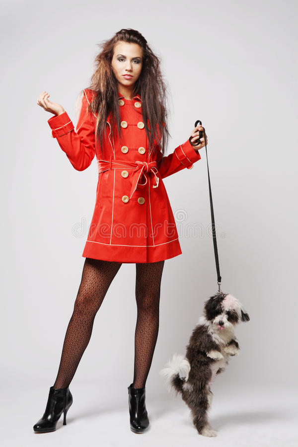 Woman in red coat with dog.
