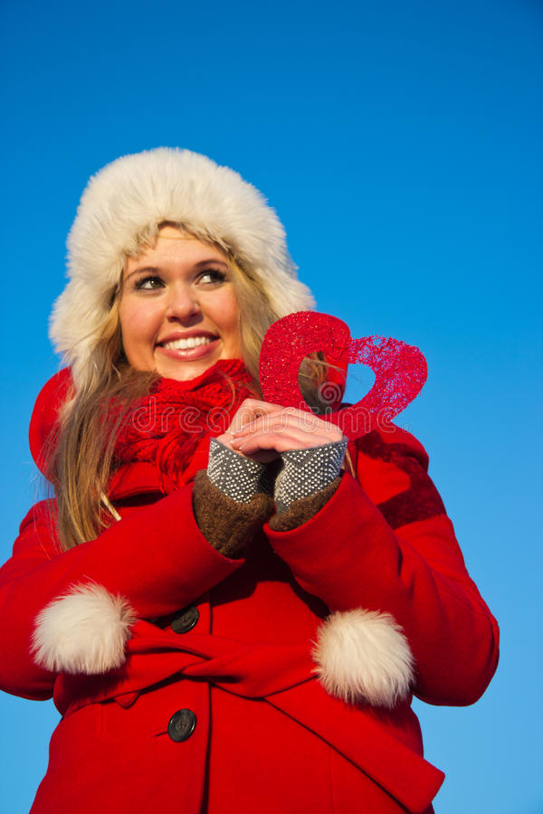 Download Woman In Red Coat Holding Heart Shape Royalty Free Stock Photos - Image: 23099868