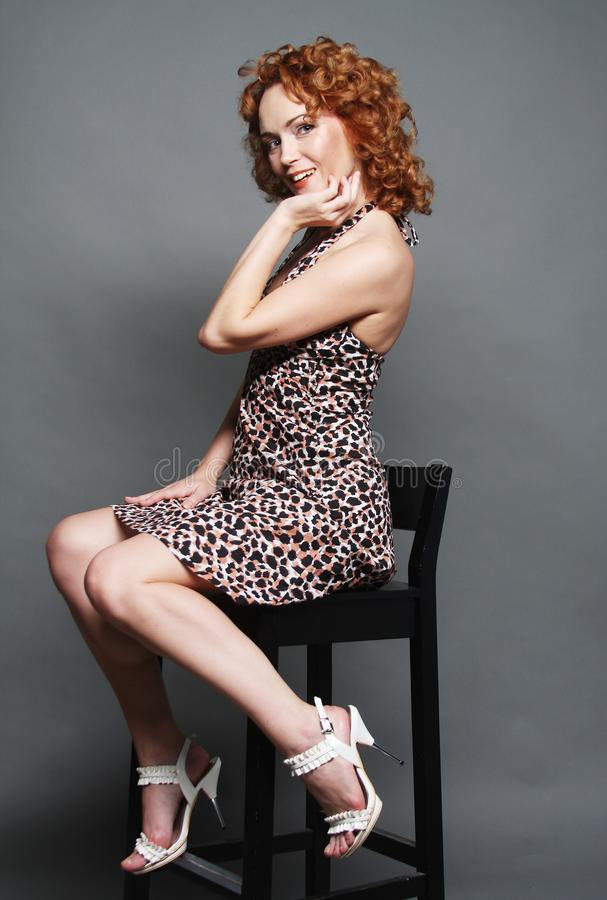 woman with red curly hair stock photography