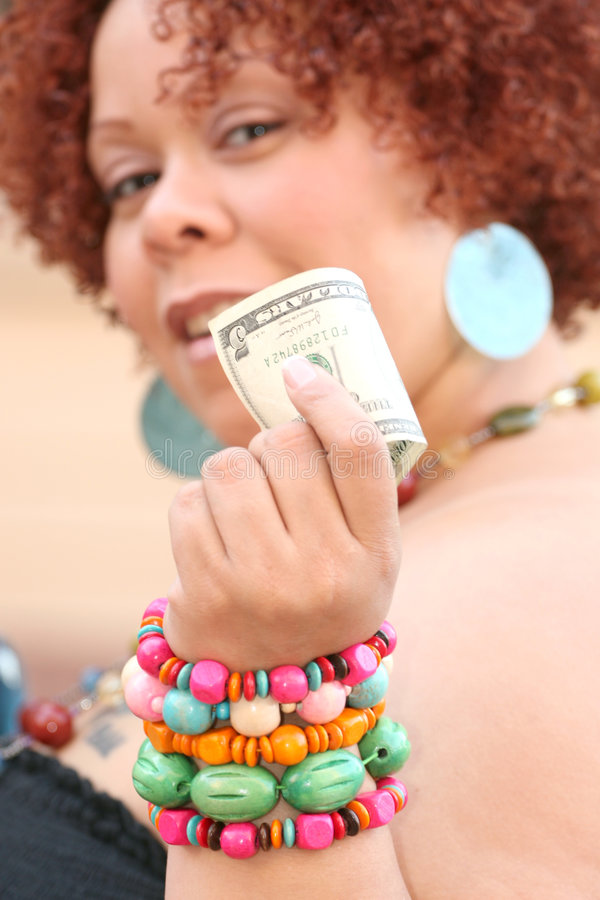 Woman With Red Curly Hair Holding Money Stock Image