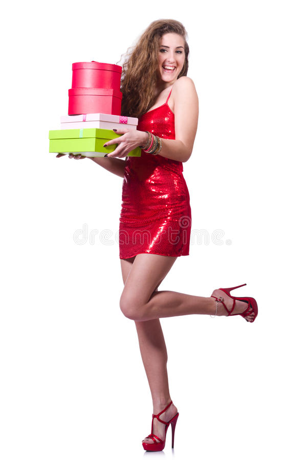 Woman in red dress. With christmas gifts stock photo