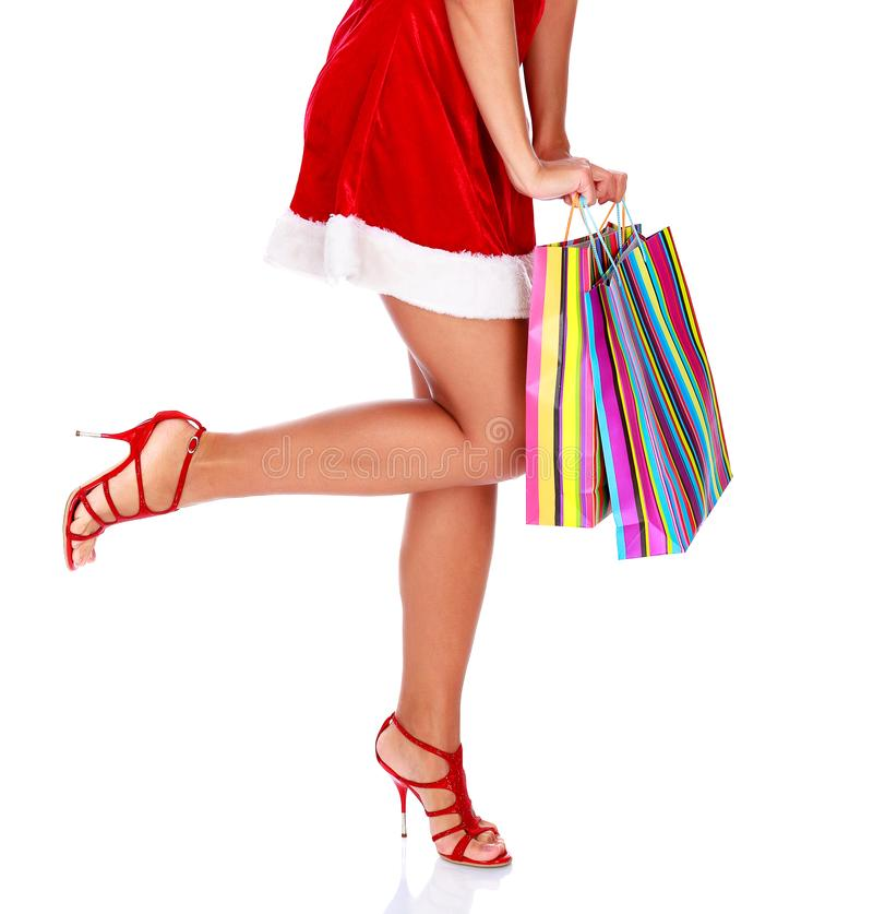 Woman in red dress with colorful shopping bags stock photography