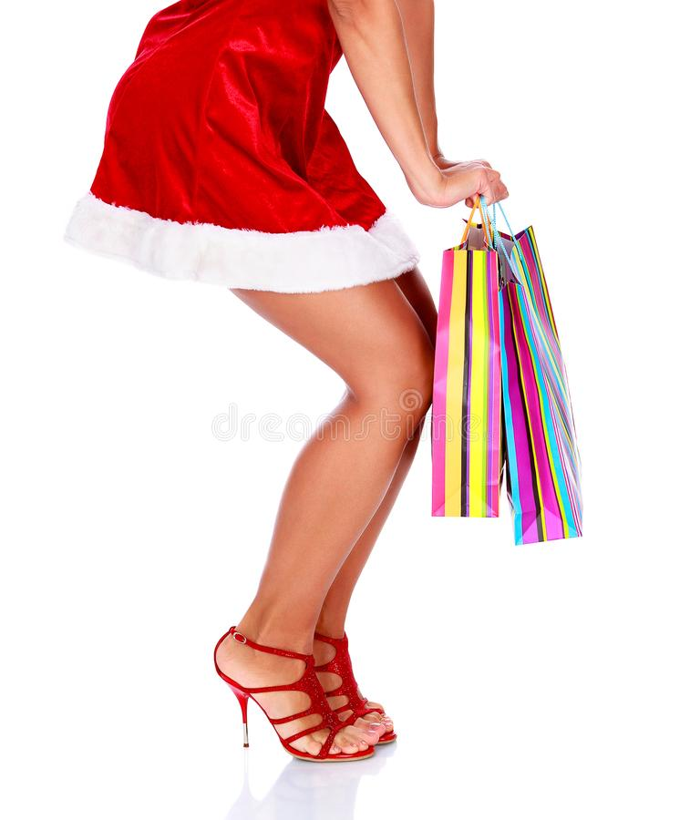 Woman in red dress with colorful shopping bags royalty free stock photo