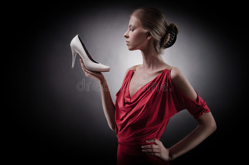 Woman in red dress. Girl and shoe stock photos
