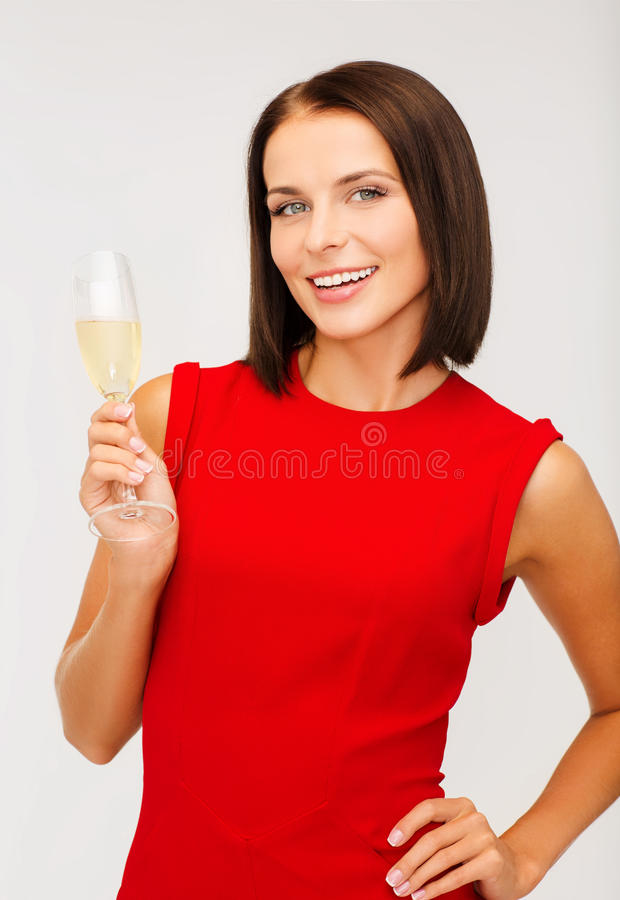 Download Woman In Red Dress With A Glass Of Champagne Stock Image - Image: 34396195