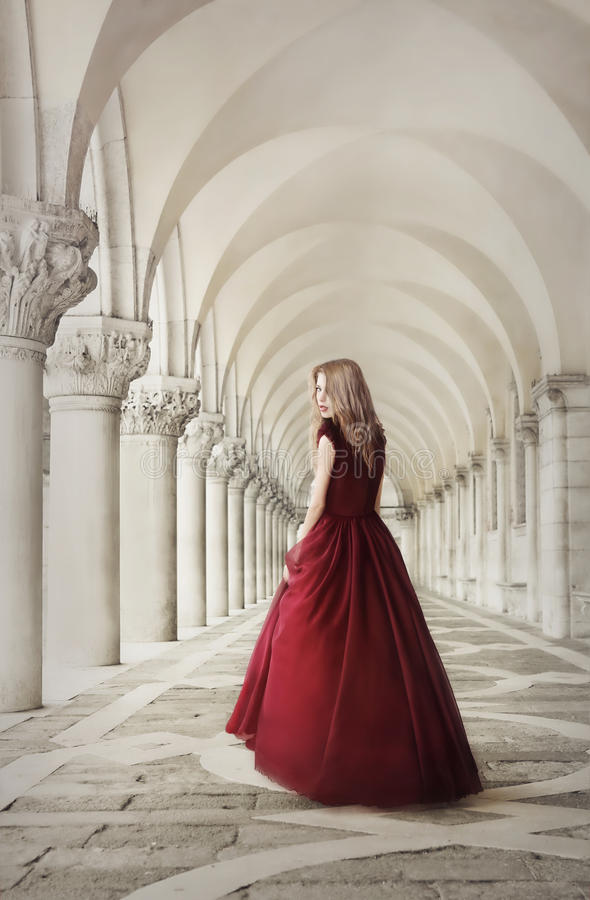 Woman in red dress near San Marco Square Venice. Woman in red dress near ancient columns, San Marco Square, Venice, Italy stock photos