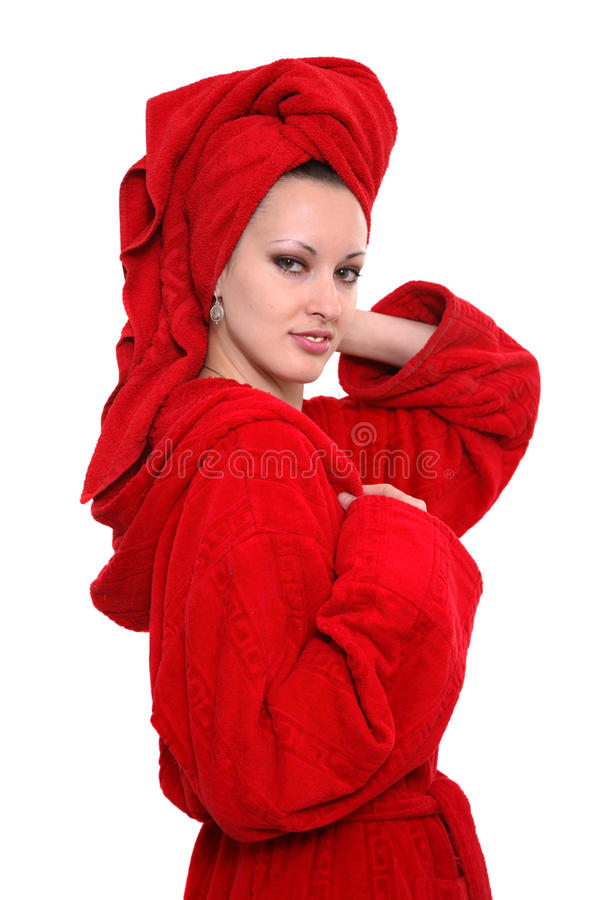 The woman in a red dressing gown on a head a towel stock photo