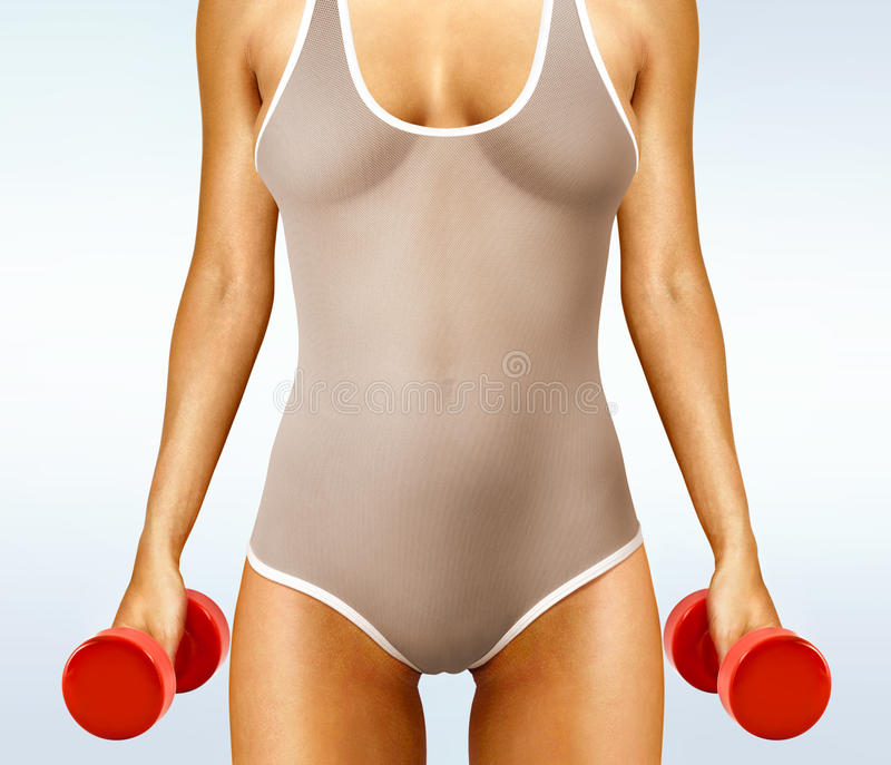 Woman With Red Dumbbells Royalty Free Stock Photography
