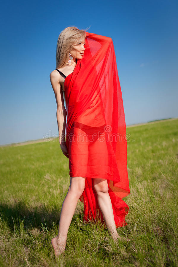 woman with red fabric on a nature