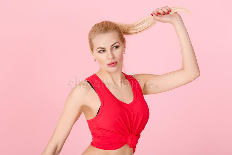 Woman in red fitness clothes stock image