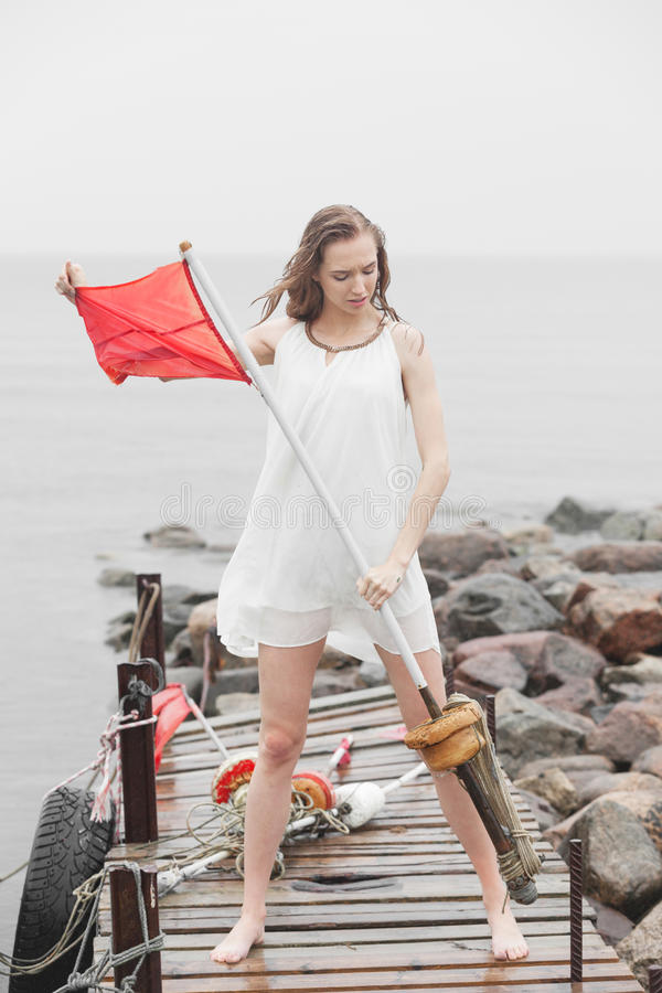 Woman with red flag. Desperate woman with red flag stock photos