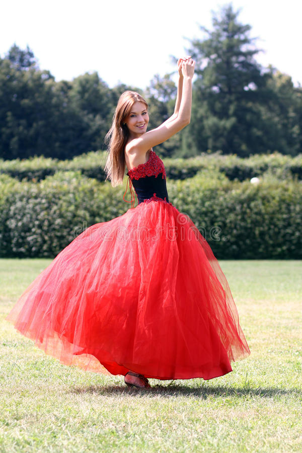 Woman in a red gothic dress. Young woman in a red gothic dress royalty free stock images