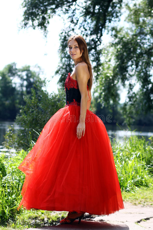 Woman in a red gothic dress. Young woman in a red gothic dress royalty free stock photo