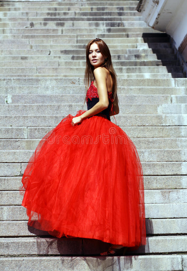 Woman in a red gothic dress. Young woman in a red gothic dress stock photography