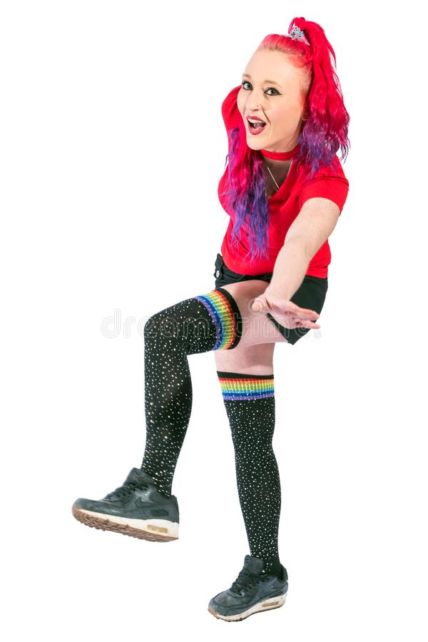 Woman with red hair and red shirt balances stock photography