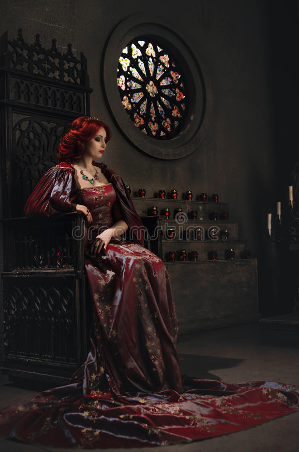 Woman With Red Hair Sitting On A Throne Stock Image