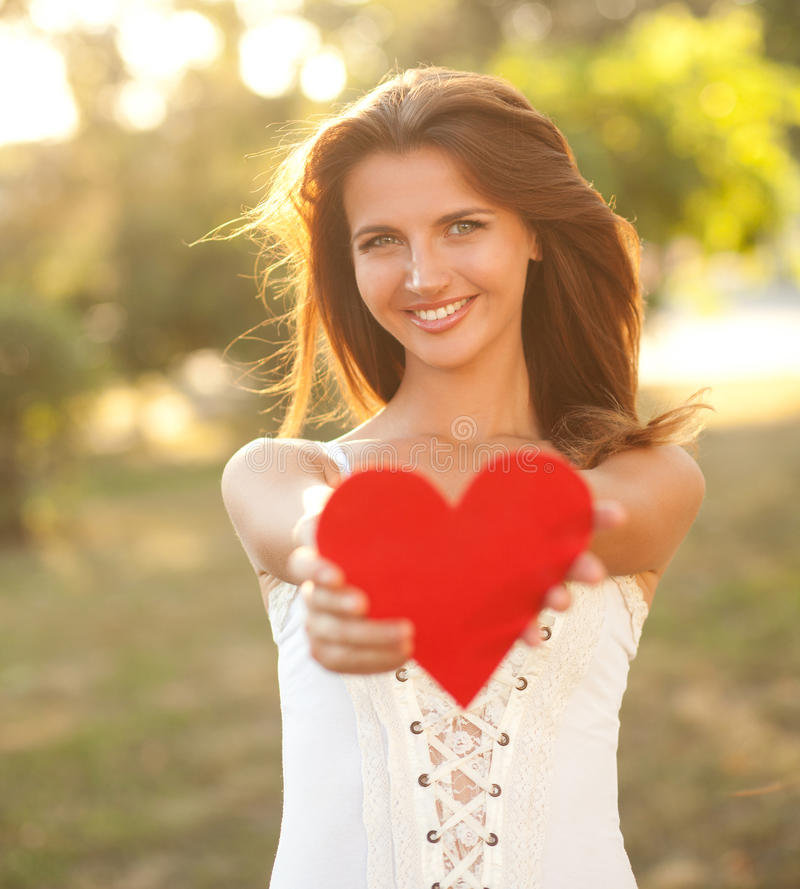 Download Woman with red heart stock photo. Image of tree, heart - 26417504