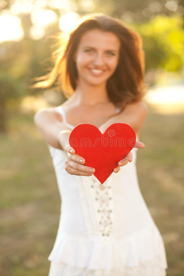 Download Woman with red heart stock image. Image of young, dress - 26813951