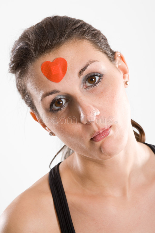 Woman with red heart bandage stock photography