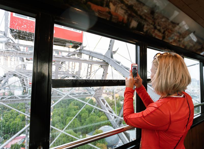 A woman rides on a ferris wheel in Vienna, Austria. royalty free stock photos