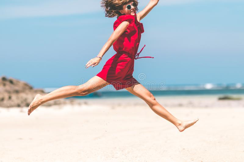 Woman In Red Jumping royalty free stock images