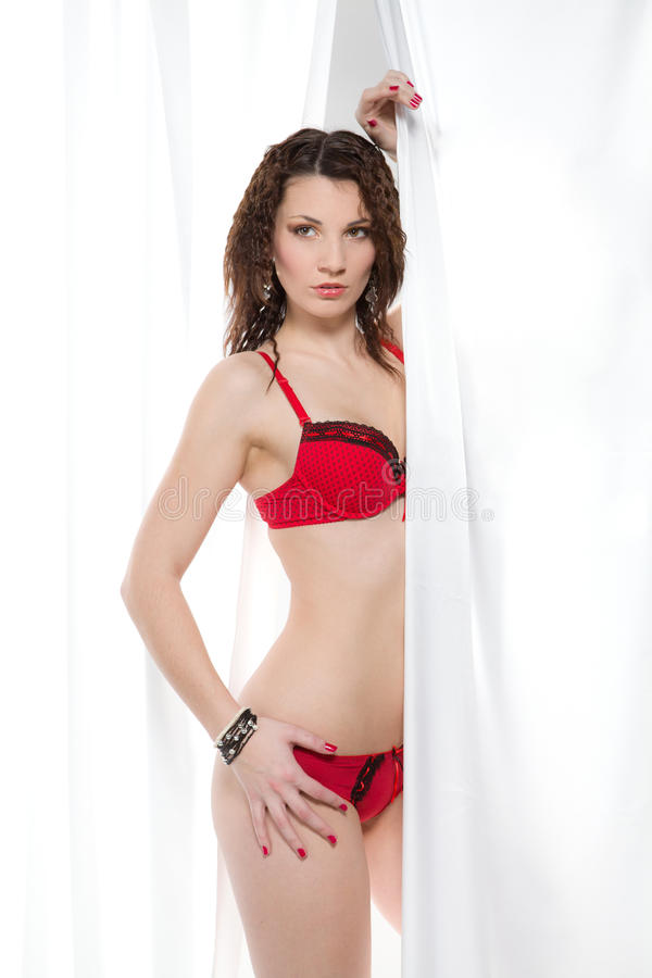 Woman with red lingerie partially