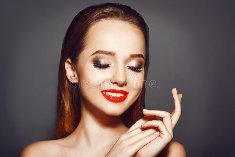 Woman with red lips.Cosmetics, beauty and make up. Beautiful young woman with clean fresh skin .Girl beauty face care. Facial treatment .Brunette girl with royalty free stock photo
