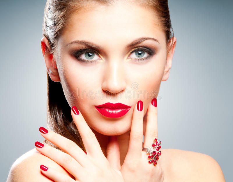 Woman with red lips and manicure. Beautiful girl with bright red nails royalty free stock images