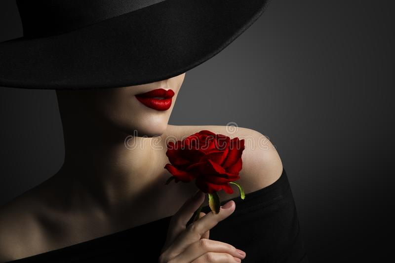 Woman Red Lips and Rose Flower, Fashion Model Beauty Portrait. In Retro Hat on Black background stock photos