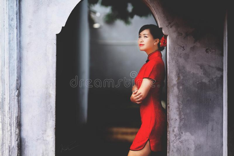 Woman In Red Mini Dress Leaning On Wall Free Public Domain Cc0 Image